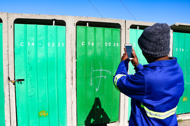 CitySpec worker inspecting toilet blocks in Monwabisi Park, Khayelitsha, May 2019