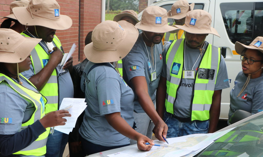 Fieldworkers going over maps for the 2019 eThekwini Safety Audit