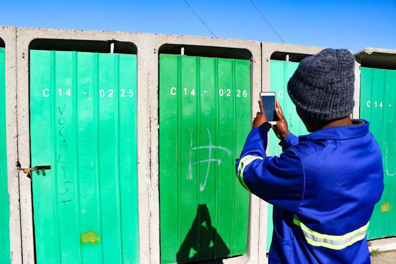 CitySpec worker inspecting toilet blocks in Monwabisi Park, Khayelitsha, May 2019